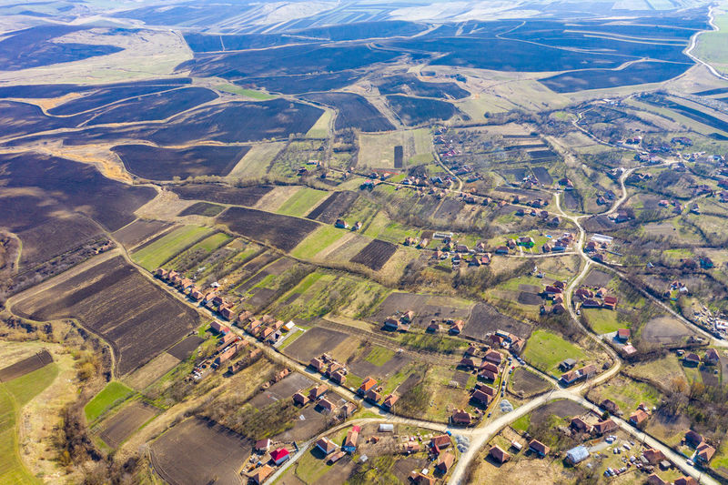 Aerial view of houses on landscape