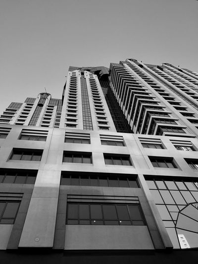 """Tower Power"" A powerful example of architecture dominating its local on a street in San Francisco, California. Building Exterior Architecture Low Angle View Built Structure City Skyscraper Tall Tower High Rise Modern Monochrome Blackandwhite Blackandwhite Photography Urban Geometry Urban"