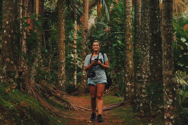 Mobile Conversations Women Around The World Full Length Forest Tree One Person Front View Nature Portrait Standing Adults Only Outdoors People Young Adult Day Only Men Real People Adult One Man Only Beauty In Nature Connected By Travel