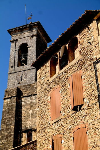 Architecture Bell Tower Blue Blue Sky Chateauneufdupape Church Eye4photography  EyeEm Best Shots EyeEm Gallery EyeEmBestPics Fortified Wall France From My Point Of View Grand Cru Historic History Low Angle View Provence Stone Stone Wall The Past The Week On EyeEm Tower Wine Wine Tasting