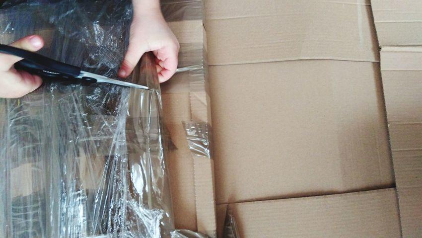 Unboxing Tape Cardboard Box Scissors Kids Hands Childhood EyeEm Selects Human Hand Home Improvement Domestic Life Home Interior DIY Holding Renovation
