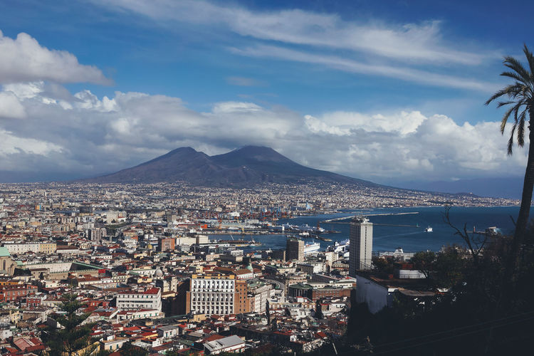 View to Vesuvius volcano in Naples in Campania Italia Naples Napoli Sightseeing Tourist Tourist Attraction  Traveling Travelling Vesuvio City Cityscape Europe Famous Place Italy Landscape Mountain Residential District Settlement Sky Tourism Tourist Destination TOWNSCAPE Vesuvius  Volcano