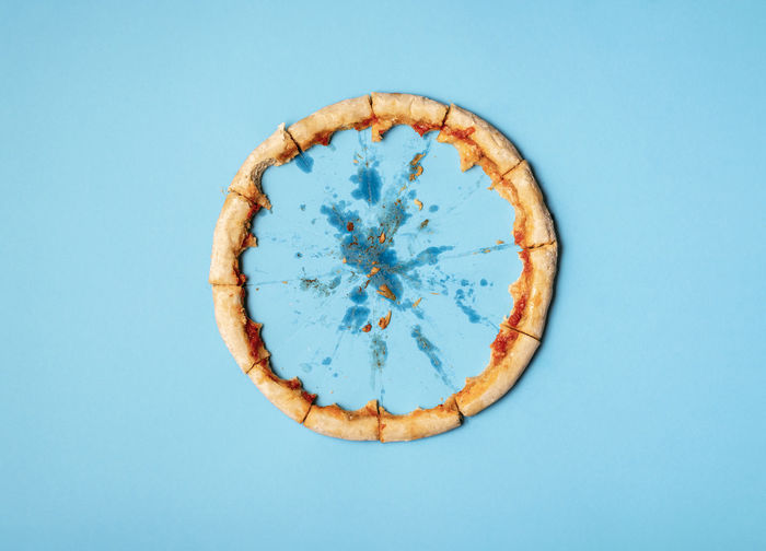 Directly above shot of bread against blue background