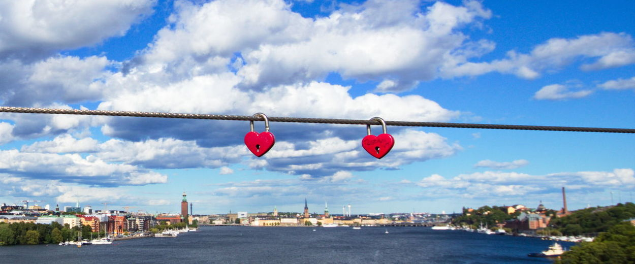 Heart shaped bridge locks on Västerbron in Stockholm, of Stockholm seen from above the water. Architecture Bridge Lock Bridge Locks Built Structure City Cityscape Cloud - Sky Day Heart Shape Love No People Outdoors Sky Water EyeEmNewHere