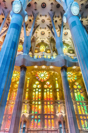BARCELONA - AUGUST 9: Interior design of the Sagrada Familia, the most iconic landmark designed by Antoni Gaudi in Barcelona, Catalonia, Spain, on August 9, 2017 Low Angle View Built Structure Architecture Belief Religion Place Of Worship Building Spirituality Representation Human Representation No People Art And Craft Building Exterior Creativity Architectural Column Sculpture Craft Ornate Ceiling
