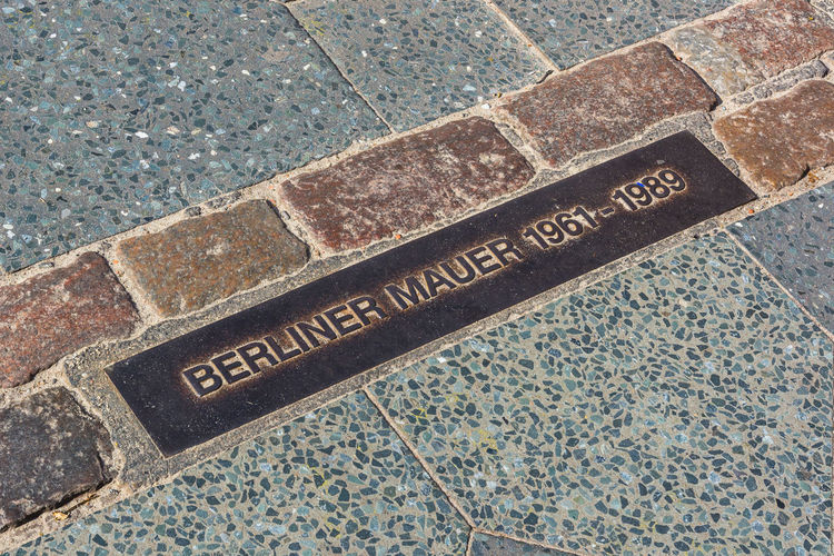 Berlin Wall street sign Berlin Berlin Wall Berliner Mauer Close-up Cold War Deutschland Germany Ground No People Travel Travel Photography Battle Of The Cities