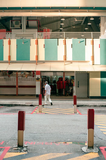 uncle ii City Life Urban Singapore Architecture And People Streetphotography Street Photography Rear View Old Man Elderly Man Portrait Of A Man  Singapore Streets City Men Full Length Architecture Walking City Street Crosswalk