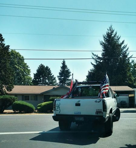 Ignorant Pride Flare Flag Big Truck White Trash Blue Sky Summer Drive