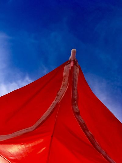 Sky Low Angle View Blue Textile Cloud - Sky Red No People Building Exterior Hanging Clothing Sunlight Built Structure Outdoors Nature Building Pattern Day Close-up Architecture Roof