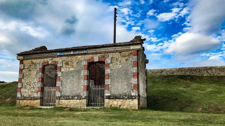 Abandoned train station in Oradour Sur Glane Sky Architecture Built Structure Abandoned Old Cloud - Sky Building Exterior No People Field Day Damaged Weathered Outdoors Grass Agriculture France House Trainstation The Week On EyeEm