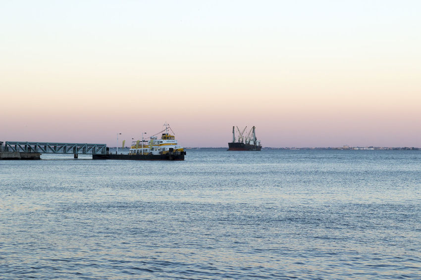 The end of the day, Lisbon Business Finance And Industry Day End Of The Day Lisbon Industry Lisbon Nautical Vessel No People Outdoors Portugal Sea Sky Sun Rise Tejo River Transportation Water