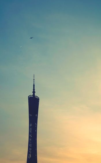 Passingby Showcase July Check This Out Hanging Out Taking Photos Relaxing Enjoying Life Hello World Streetphotography Silhouette Tower Guangzhou Sky And Clouds Architecture Urbanexploration Sunset Airplane Cantontower Daytime Moon Moon