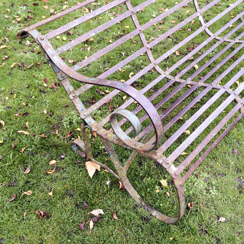 Old ornate wrought iron park bench Absence Architecture Bench Bench Curves Design Empty Empty Chair Grass Lines Metal Chair Metal Work No People Old Ornate Outdoors Park Park Bench Rusty Metal Sculpture Seat Vacant Wrought Iron Wrought Iron Design