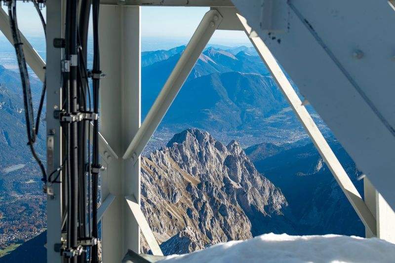 Ski Lift Over Snowcapped Mountains Against Sky
