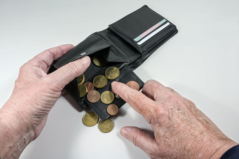 High angle view of hand holding coins