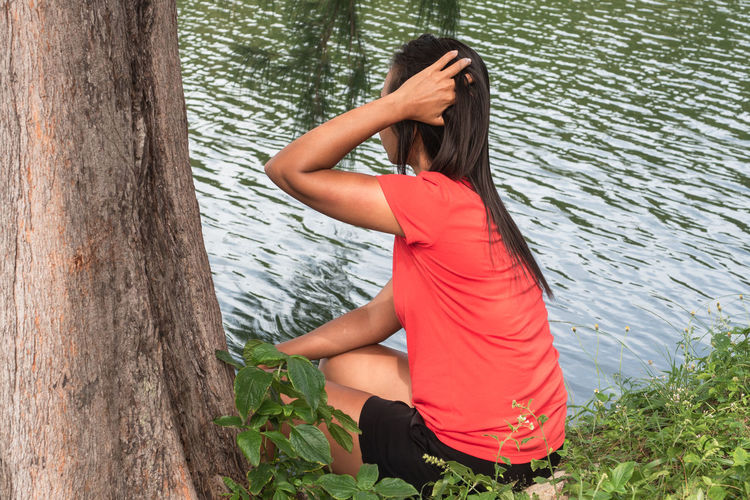 Midsection of woman in park