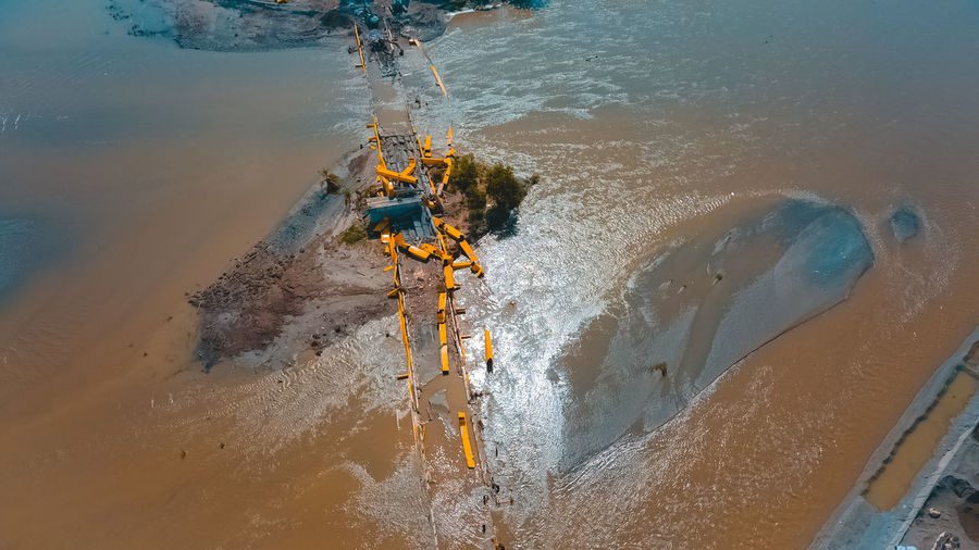High angle view of damaged bridge in flood