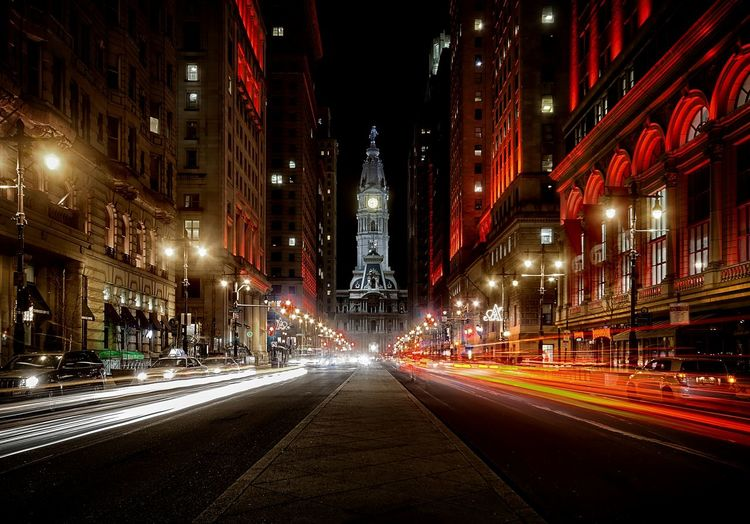 Light Trails On Road Leading Towards Philadelphia City Hall At Night