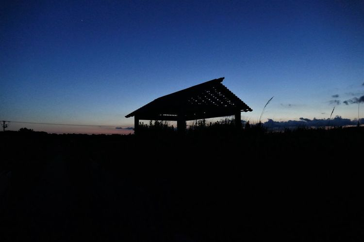 BEACH SUNSET Beach Structure Outer Banks, NC Shack Sunset At The Beach Silouette & Sky Architecture Beauty In Nature Blue Blue Sky And Clouds Building Exterior Built Structure Clear Sky Day Nature No People Outdoors Roof Silhouette Sky