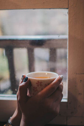 Holding cup of tea near window Drink Food And Drink Holding Real People Refreshment Cup One Person Human Hand Mug Lifestyles Human Body Part Hand Window Tea Hot Drink Indoors  Coffee Leisure Activity Focus On Foreground Tea - Hot Drink Body Part Tea Cup Finger Drinking Glass Interior Wish Wishing Coziness Vintage Dairy Vacation Vacations Relaxation Comfortable Life Breakfast Rest Holding Hands Brewed Latte Peace Tasty Aroma Aromatherapy Closeup Morning Calm Calmness Soft Coffee Cup Caffeine Coffee Break Season  Weekend Mood Cozy Tea Window Warm