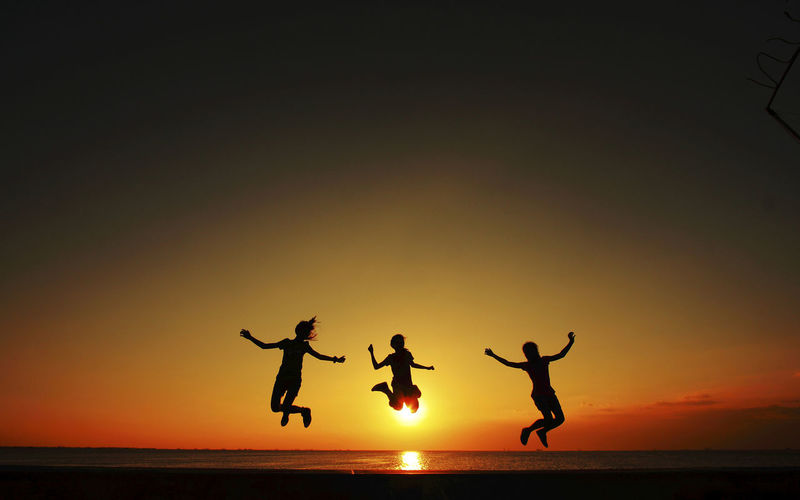 Beach Day Energetic Excitement Full Length Jumping Leisure Activity Live For The Story Men Mid-air Nature Orange Color Outdoors People Real People Scenics Sea Silhouette Sky Sunset Togetherness Water Mix Yourself A Good Time
