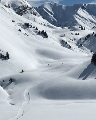 Scenic view of snow covered mountains in lech