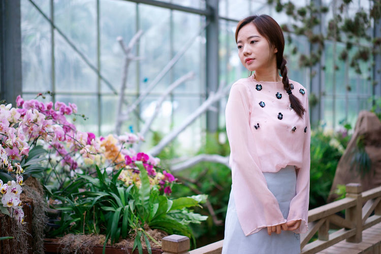 Beautiful Woman Beauty Contemplation Flowering Plant Hair Hairstyle Lifestyles Plant Standing Women Young Women