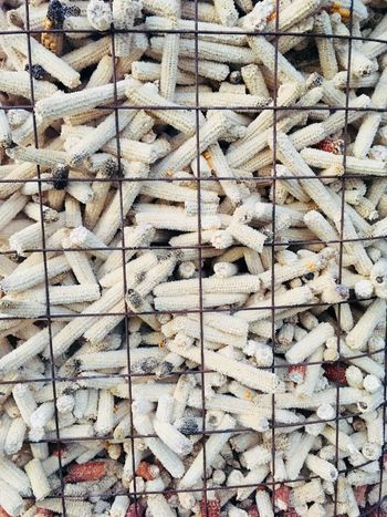 Corn Backgrounds Full Frame Pattern No People Textured  Wall - Building Feature Day Repetition Built Structure Design Close-up White Color Large Group Of Objects Outdoors Wood - Material Abundance Architecture Brown Textile Nature