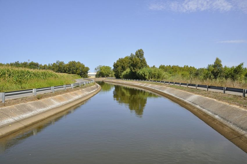 Sardinia Water Reflection Travel Destinations Tree Landscape Outdoors No People Sky Nature Day City River Channel Summer Mediterranean  Drainage Channel Water Collection  Rural Scene