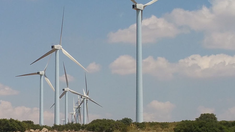 wind turbines Fuel And Power Generation Wind Turbine Wind Power Turbine Sky Cloud - Sky Day Nature No People Outdoors Field Technology Land Tree Sunlight Power Supply Windmill Windmills Unreliable
