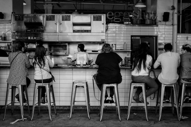 Mealtime. Streetphotography Streetphoto_bw Blackandwhite Urban Lifestyle Everyday Lives People Cityscapes Monochrome Snapshots Of Life Black And White Exceptional Photographs The Street Photographer - 2016 EyeEm Awards Monochrome Photography