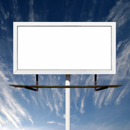 Low angle view of empty sign against sky