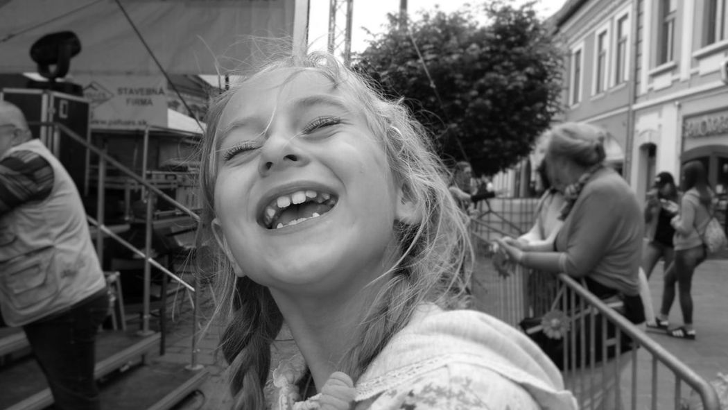 Happy young girl at town festival Child City Smiling Crowd Happiness Blonde Girl Beautiful Child