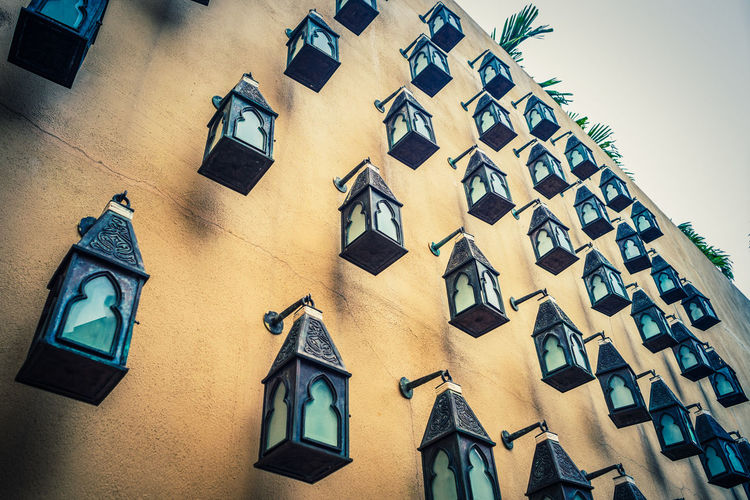 Low angle view of lanterns hanging on wall