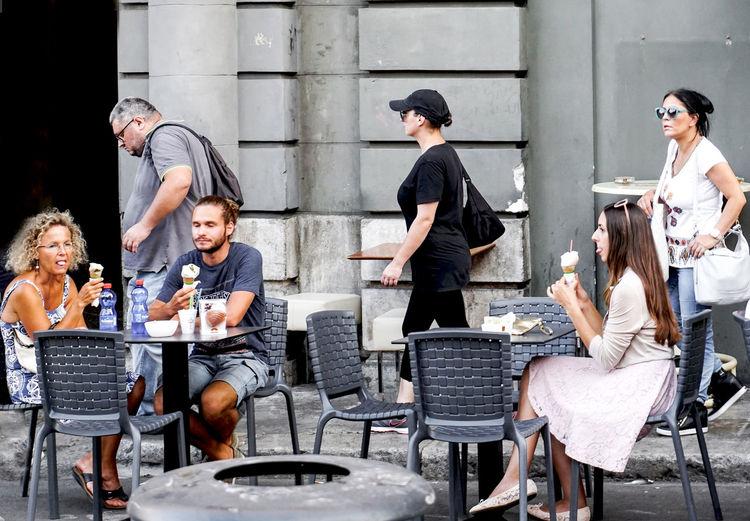 ice cream eating people in Palermo, Italy Ice Cream Palermo Street Scene Streetphotography Street Photography Group Of People Sitting Eating