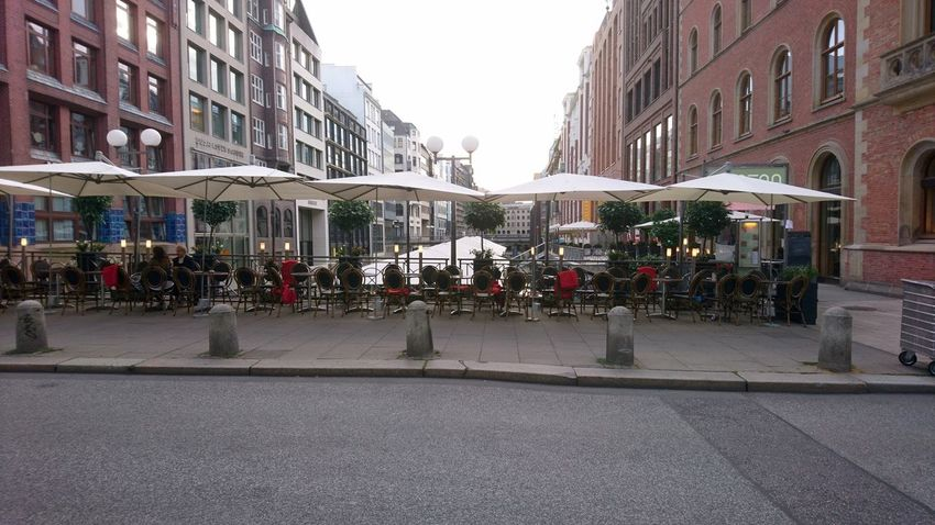 Charm of Hamburg. Hamburg Germany Hh Hansestadt Hansestadt Hamburg Hanseatic Altstadt Umbrella Umbrellas Architecture Charm Summer Urban Landscape City Life Coffee Asphalt City Politics And Government Road Street City Street Royal Person Architecture Sky Building Exterior Built Structure