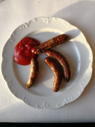Directly above shot of sausages in plate on table