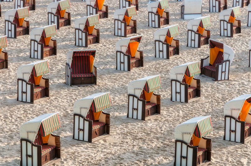 High angle view of chairs on beach