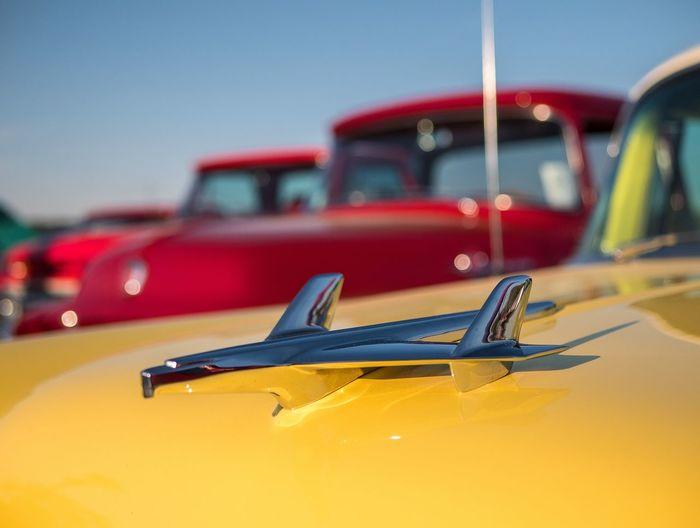 hood ornament and classic car show colors Colours Shapes Colors Blue Gold Close-up Vintage Car Collector's Car Convertible Sports Car Vehicle Hood Parking