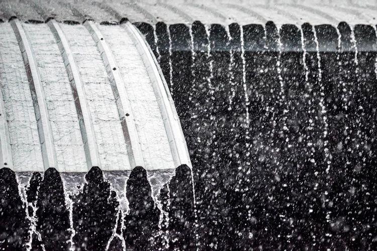 Close-up of water splashing on wall