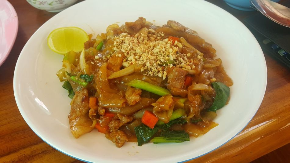 Stir fried ribbon noodle with pork Food Thailand Korat Thailand Thailand Street Foods Plate Chopped Chinese Food High Angle View Table Close-up Food And Drink