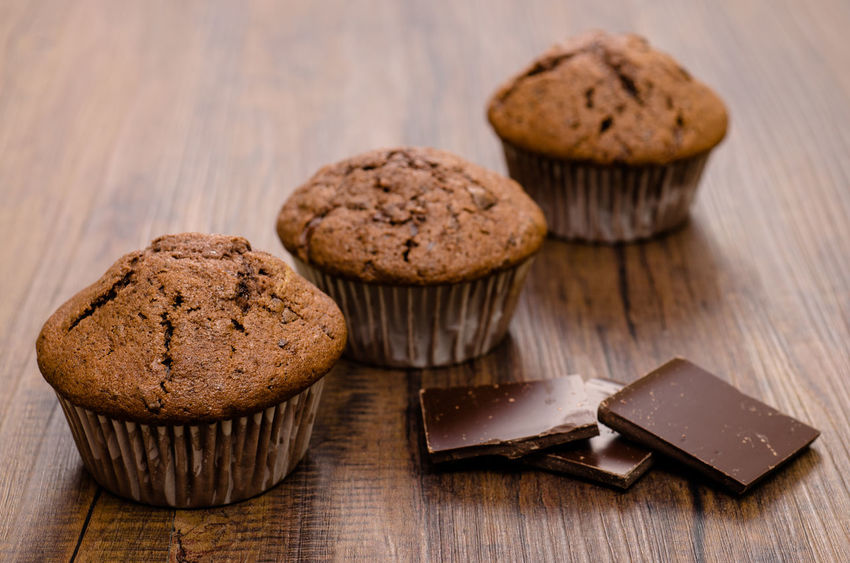 Chocolate muffins Chocolate Baked Close-up Cupcake Day Dessert Food Food And Drink Freshness High Angle View Homemade Indoors  Indulgence Muffins No People Peanut Butter Ready-to-eat Sweet Food Table Temptation Unhealthy Eating Wood - Material