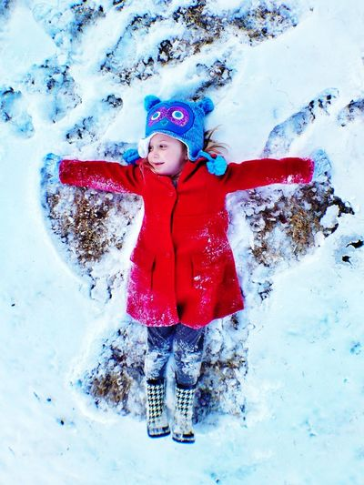 My youngest Daughter making a Snow Angel . Create Memories while you can. Feeling Thankful Fort Worth Texas Family IPhoneography IPhone5