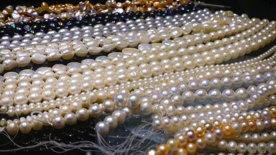 Close-up Jewelry Backgrounds No People Pearl Jewelry Full Frame Wealth Necklace Abundance Selective Focus Luxury Shiny Bead Large Group Of Objects Elégance Gift Woman Girl Wedding Valentine's Day  Rich Beautiful Silver Colored Precious Gem White Color Seashell Glitter Shining Bride Expense