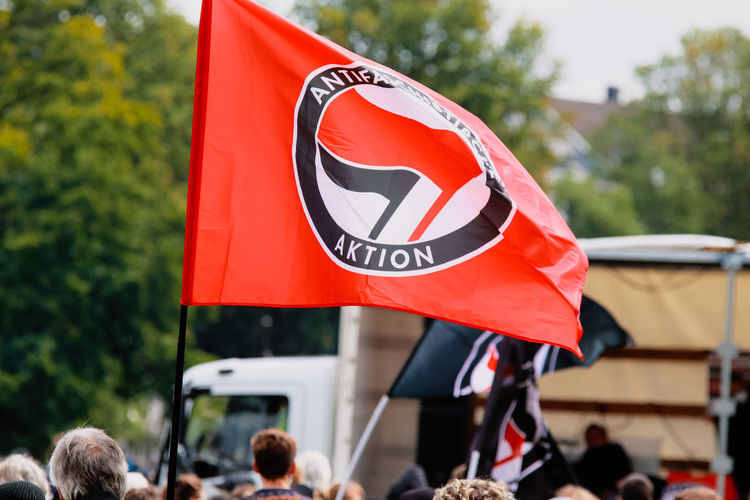 Group of people against red flag