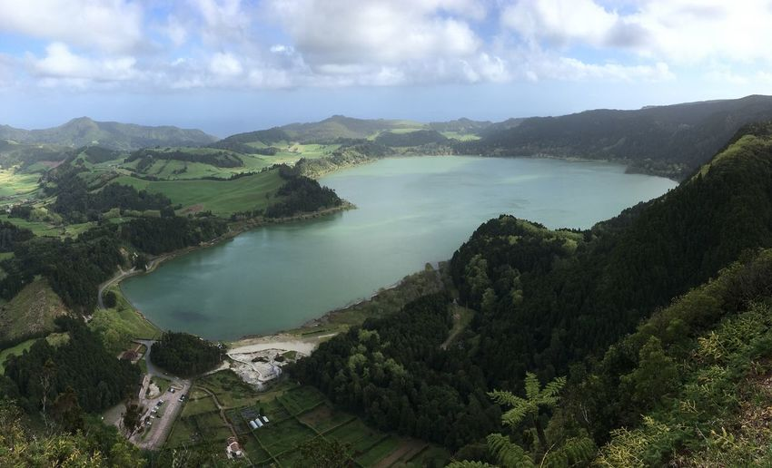 Lagoa das Furnas from above Furnas Tourism Açores - São Miguel Azores Portugal IPhoneography Cloud - Sky Scenics - Nature Water Sky Tranquil Scene Tranquility Beauty In Nature Non-urban Scene No People Mountain Tree Land Day High Angle View Green Color Nature Plant Sea Environment Outdoors