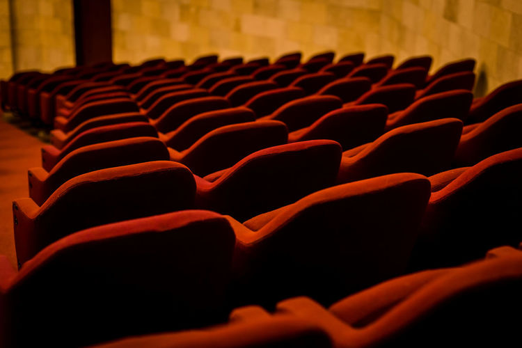 Empty red chairs in theatre