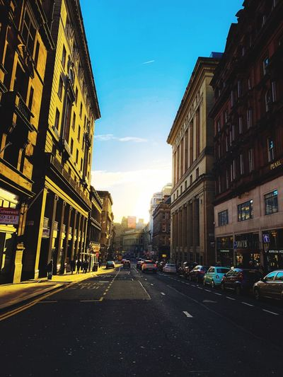 Architecture Building Exterior City Built Structure Sky Transportation Car City Street Outdoors Residential District Nature Road No People Land Vehicle Building Motor Vehicle Mode Of Transportation The Way Forward Street Direction