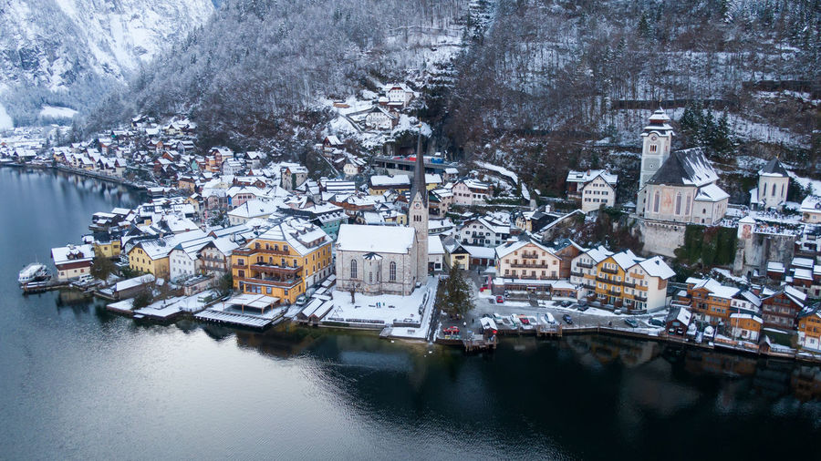 Aerial view of townscape by river during winter