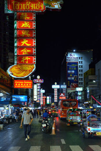Chinatown Bangkok Illuminated Architecture City Night Building Exterior Built Structure Text City Life Transportation Real People Communication Group Of People Street Motor Vehicle Mode Of Transportation Men Car Script Non-western Script Land Vehicle Outdoors Bangkok China Town